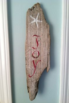 TREASURY ITEM Large Reclaimed Painted driftwood Joy starfish sign. $26.50, via Etsy.