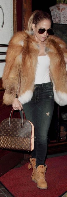 Who made  Jennifer Lopez's brown print handbag, white print top, aviator sunglasses, and tan ankle boots?