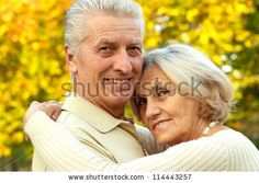nice old couple posing at autumn park by Aletia, via ShutterStock
