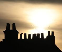 Rooftop Silhouette Photo by Ruth P. — National Geographic Your Shot -- Taken when I was in York on Christmas break. Saw my opportunity and took a few shots, even if it meant getting left behind. XD The lighting, to me, was perfect at the time, bringing out a stark contrast on the rooftop to the sunrise behind it, as well as highlighting a little the soft texture of the clouds. :-)