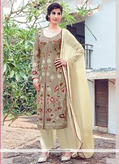 Be your own style icon with cream cotton satin churidar designer suit. The embroidered work on attire personifies the entire appearance. Comes with matching bottom and dupatta. (Slight variation in co...