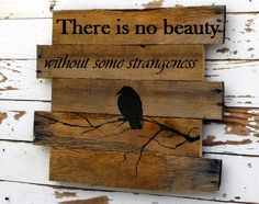 """Wood sign with Edgar Allen Poe quote """"there is no beauty  with out a little strangeness"""""""