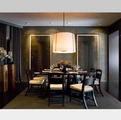 Black table, oversized hanging lamp, black and white contemporary dining chairs