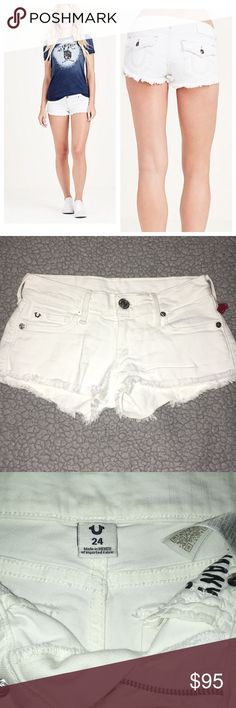 """True Religion Joey Cut Off Shorts White Size 24 Brand new and sold out! True religion Joey Cut Off Shorts with flap back pockets. Frayed hems. Size 24. The Joey Cut Off Short is a classic denim short in a low rise. Flared raw detail hems give this a touch of edge- pair with a graphic tee for a casual look, or dress them up! 93% Cotton, 6% polyester, 1% elastane 6.5"""" Rise. 12.75"""" waist across. 1.5"""" inseam.  Retail $139! Fast shipping! I love offers! True Religion Shorts Jean Shorts"""
