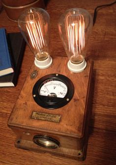Steampunk bedside lamp - dovetailed Western Electric telephone box circa 1910 with dim-able Edison bulbs and working voltmeter.