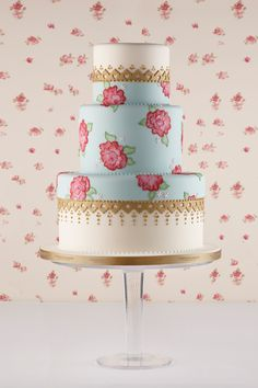 Pink, blue and gold hand-painted rose wedding cake.