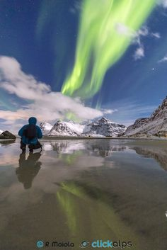 Borealis live Show - by Roberto Sysa Moiola (Looking to the aurora from the beach of Skagsanden, Lofoten. Norway. In the picture my friend photographer Kiss Zsolt.)