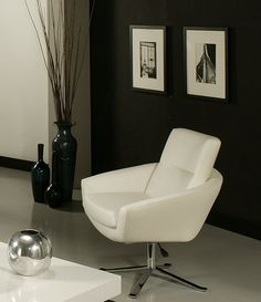 Add a contemporary touch to any room with the clean lines of this Aliante club chair. This chair is upholstered in PU Ivory and features a hydraulic adjustable lift and a sturdy chrome-finished metal base.