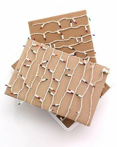 Keep lights organized by winding each strand around a piece of cardboard cut to fit inside a plastic bin.