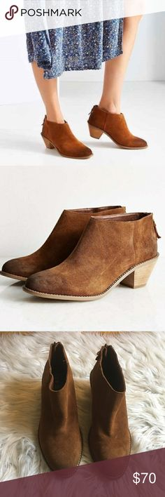 Anthropologie Kaiden Stacked Block Heel Ankle Boot A stacked block heel adds to the rustic style of a go-to ankle booty in a simplified, round-toe silhouette.   Back zip closure. Leather upper/synthetic lining and sole. By Kelsi Dagger Brooklyn; imported. BP. Shoes. Anthropologie Shoes Ankle Boots & Booties