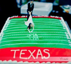 My wedding cake. I thought It was only appropriate that since I'm a Longhorns fan and he OU Sooners he would have to drag me to even leave my Texas Team! LOL Hook 'em Horns!!! #wedding #cake #weddingcake #groomscake #sooners #OU #longhorns #texas #bride #funnywedding #footballwedding #football #hookem #horns #UT