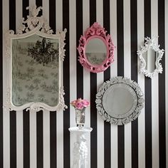 Go Gothic in a Hallway  Gothic-style frames make a real design statement, particularly when grouped together and hung against a bold background like these monochrome stripes.