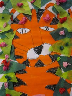 The first graders learned how to draw a simple tiger. We looked at how easy it would be to turn our tiger into a number of different animals just by changing small details. We added green and pink tissue paper to make our tigers look like they were hiding in the jungle!