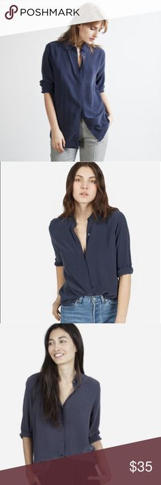 "Everlane Navy Silk Round Collar Shirt This color currently not available online. 100% silk. Gently worn. From the Everlane website: ""Our classic silk—polished and simple with a round collar. It features traditional shoulder seams and an exposed button placket. The fabric is a washed crepe-de-chine that shows a subtle lustre on darker colors."" Everlane Tops Blouses"