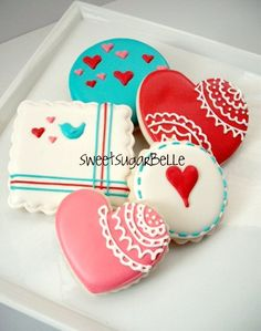 Decorated heart cookies by SugarBelle via #TheCookieCutterCompany