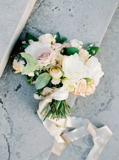 Rose, peony and lily wedding bouquet wrapped in blush ribbon: http://www.stylemepretty.com/2016/10/10/multicultural-catholic-buddhist-wedding/ Photography: Jill Dillender - http://jendillenderphotography.com/wp1/