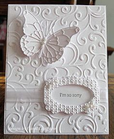 handmade sympathy card from Our Little Inspirations: Hero Arts Flourishes embossing folder and Memory Box Vivienne and Darla butterfly dies. ... white on white ... absolutely adore the layered die cut butterfly ... flourishes from embossing folder on the card front ...