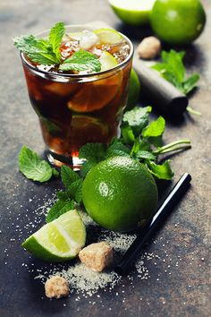 Fresh mojito drink - Ingredients for making mojitos (ice cubes, mint leaves, sugar and lime on rustic background)