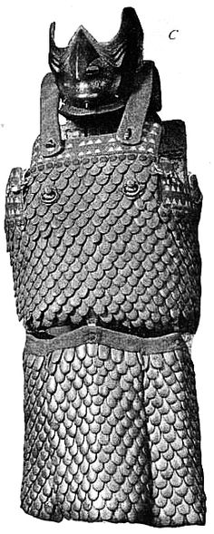 """Gyorin kozane haramaki dou.This specimen illustrates a primitive type of Japanese harness. The separate plates are of boiled leather, cut and beaten into pieces shaped like fish scales (gyorin kozane), 1000 AD, restored possibly in the 18th century, from """"Catalogue of the Loan Collection of Japanese Armor, Metropolitan Museum of Art"""", Bashford Dean, Metropolitan Museum of Art, 1903.  http://books.google.com/books?id=zV4yAQAAMAAJ&pg=PA1#v=onepage&q&f=false"""