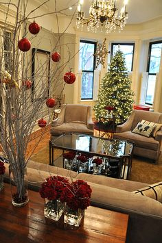 Spray paint branches white, put in tall vase, and hang red balls.  Very simple and so pretty