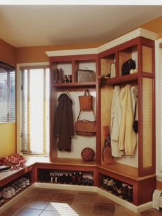 don't like colour, 3 on each side, dividers the whole length and all the way up to ceiling, bench a little wider & taller!  great mudroom idea though...may have to duplicate-AR