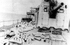 June 6, 1944 - USS Hobson (DD-464) with expended 5-in shells on her deck. 2d Naval Beach Battalion
