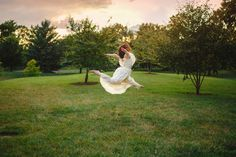 A dancer leaps in a long white dress in a tree-lined park at sunset - Buy this stock photo and explore similar images at Adobe Stock Valentines Day Cards Diy, Tree Line, Adobe, Dancer, White Dress, Stock Photos, Sunset, Explore, Park