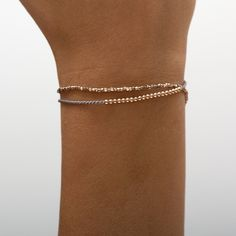 rose gold dipped sterling silver beads on grey silk cord. The beads are moveable on the silk thread. logo charm contains a tiny diamond. Silver Beads, Sterling Silver Chains, 18k Rose Gold, 18k Gold, Gold Dipped, Silk Thread, Cord, Charmed, Diamond