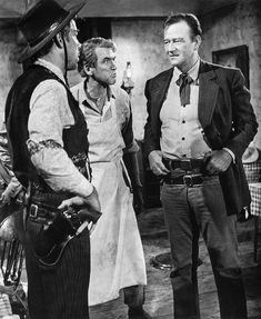 Lee Marvin,James Stewart and John Wayne-The Man Who Shot Liberty Valance Liberty Valance/Lee Marvin: You lookin' for trouble, Doniphon? Tom Doniphon/John Wayne: You aim to help me find some? John Wayne Quotes, John Wayne Movies, Hollywood Stars, Classic Hollywood, Old Hollywood, Old Movies, Great Movies, Iowa, Old Western Movies