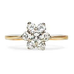 How lovely is this flower-shaped diamond ring?