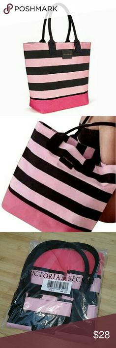 """Victoria's Secret Canvas Tote Victoria's Secret Canvas Tote Striped pink and black canvas exterior, black nylon lined interior Approx 15.5""""L x 13.5""""W x 6.5""""D Black handles in canvas material are padded to hold their shape, Approx 10"""" strap drop Brand new and unused in packaging (no tag) Only removed to confirm no damage and get measurements Victoria's Secret Bags Totes"""