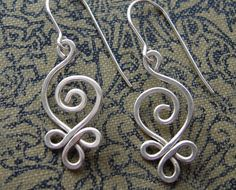 I like these - swirls + loops -- lots of beautiful earrings & other wire work in this Etsy shop