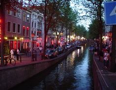 The Red Light District, famous for prostitutes standing in red-lit windows, sex shops and marijuana-selling coffeeshops, is the oldest part of Amsterdam. Don't take pictures of women in the windows and be sure to watch out for pickpockets.