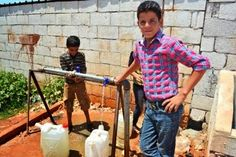 These boys in northern #Syria wash and fill water containers to take back to their tents for their families. The IRC provided this water point, the clean water, and the tank to store it at this camp for displaced Syrians.  Learn more: http://Rescue.org/SyriaCrisis