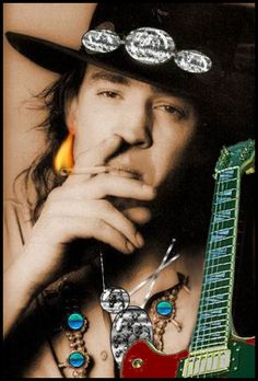 Stevie Ray Vaughn there's that hat I love...the silver accents...woot..woot!