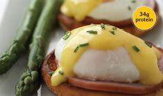 """EGGS BENEDICT - A classic poached egg with Canadian-style bacon and an easy Hollandaise sauce. Substitute smoked salmon for a twist on this brunch favorite. Use very fresh eggs for poaching. They hold their shape better and form fewer wispy threads or """"angel wings"""" in the water. Do not swirl the water when poaching eggs. This creates a vortex that will ruffle the delicate egg protein. Relatively quiet water that is gently simmering produces the best result. Easy Hollandaise Sauce, Eat Breakfast, Breakfast Dishes, Breakfast Recipes, Egg Protein, Incredible Eggs, Egg Recipes, Muffin Recipes, How To Cook Eggs"""
