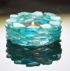 Our exclusive beach glass candle holder is a must have for your decor! Each candle holder is handcrafted by LaurieAnn, owner of nebeachco. With over thousands sold, it remains our most in demand item. Gorgeous shades of teals, blues, and white beach glass Sea Glass Crafts, Sea Glass Art, Seashell Crafts, Beach Crafts, Marble Crafts, Sea Glass Decor, Sea Glass Mosaic, Sea Glass Beach, Fused Glass