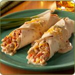 Classico Chicken Enchiladas -  2 teaspoons olive oil 1 cup diced white onion 3 cups precooked grilled chicken strips, shredded 1 can (14.5 oz.) diced tomatoes, drained 1 jar (15 oz.) Classico® Roasted Poblano Alfredo Pasta Sauce 1 cup shredded Mexican-style cheese, divided 12 6 in. flour tortillas