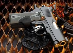 Kimber Ultra Carry II in .45 ACP with Crimson Trace Laser grips.