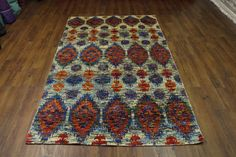 Amazing one of a kind SARI Rug. Handknotted 100% Wool pile with Sari art Silk design / highlights. View the photos to see the specter of colors such as vanilla, orange, purple, denim, lime & aqua. Exact size is 7'10 x 4'9