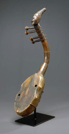Africa | Harp from the Zande people of DR Congo | Wood, and hide rich honey-brown patina with areas of black pigment | ca. 1885 | Now missing its strings
