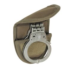 The newly designed single handcuff pouch fits most linked and hinged handcuffs. Voodoo Tactical, Tactical Vest, Tactical Clothing, Handcuff Case, Tac Gear, Everyday Carry, Firearms, Snug Fit, Tactical Gear
