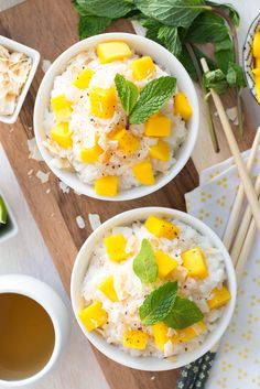 A new twist on Coconut Sticky Rice with Mango; incorporating rich coconut cream, toasted coconut flakes, spicy cinnamon sugar, lime & mint.