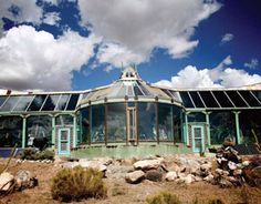 Earthship: a home design that uses recycled materials and nature's own solar machinery to create snug, self-sufficient houses. These houses are so cool.