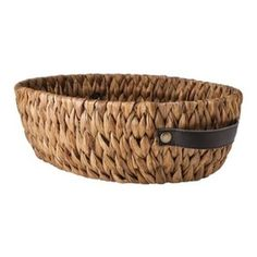 Capture all of the little goodies you've gathered for those stopping through your home in this classic basket. The leather handles give it the ideal extra touch. Nate Berkus Oval Basket, Earth... $16.99