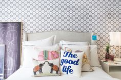 "Colorful pillows add flair to the bed's muted neutrals.   <p><a href=""http://m.bloomingdales.com/shop/search?keyword=jr%20by%20john%20robshaw%20decorative%20pillows"" target=""_blank"">John Robshaw Pillows</a> // <a href=""http://m.bloomingdales.com/shop/product/alexandra-ferguson-the-good-life-decorative-pillow-16-x-16?ID=1540793"" target=""_blank"">Alexandra Ferguson Decorative Pillow</a> // <a…"