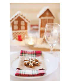 Mad For Plaid: Certain patterns go hand-in-hand with the season. Gingham is to summer as plaid is to winter. Keep your dinner tables simple and add texture with your napkin treatment. The gingerbread snowflake cookie is a charming touch.