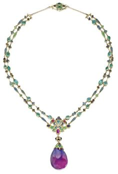 Full view of an Art Nouveau necklace by Louis Comfort Tiffany of Tiffany & Co., circa 1914-1927. Champlevé enamel, emeralds, and sapphire drop.