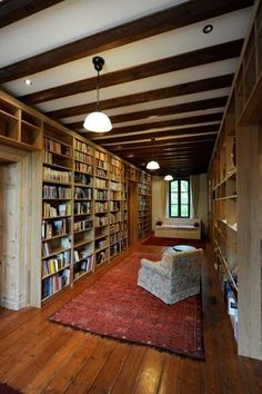 This French country house library has 60 Billy bookcases, stained to match the trim in the room. Get all the details at IKEA Hackers.IKEA Billys 10 Ways: The World's Most Versatile Bookcase