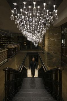 Hedonism Wines light feature by Jonathan Coles, via Behance | How cool would this be in a wine cellar?